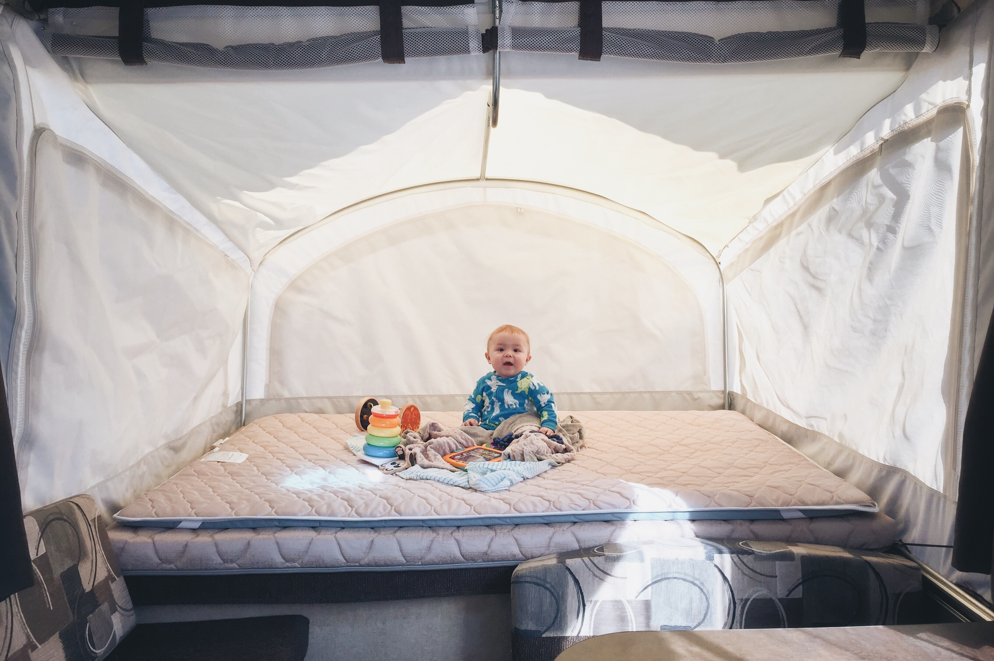 Owen - 8 Months old - checking out his bunk.